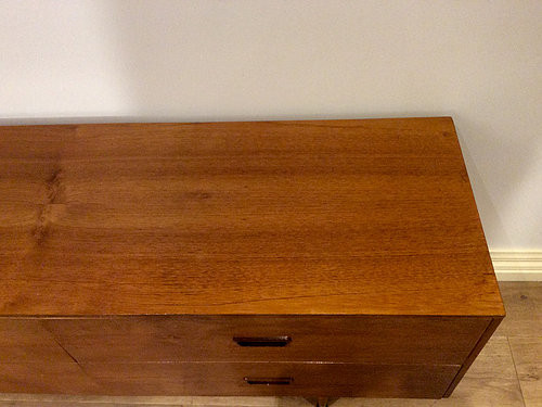 Top View Mid Century Danish Four Drawer Walnut Sideboard with Atomic Legs. Circa 1960.
