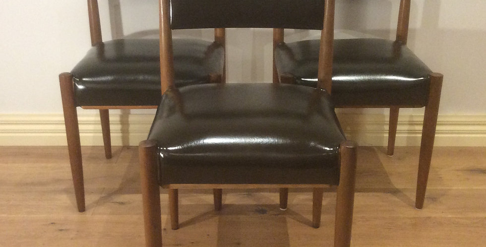 Three Danish Designed Mid Century Teak & Vinyl Chairs.