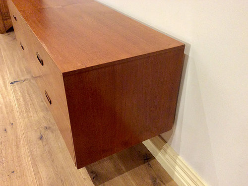 Right Side View Mid Century Danish Four Drawer Walnut Sideboard with Atomic Legs. Circa 1960.
