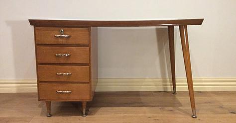 Mid Century Oak Four Drawer Desk with Atomic Legs. Circa 1960.