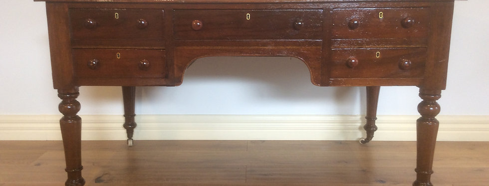 Victorian Cedar Five Draw Leather Inlay Desk on Rolling Castors.