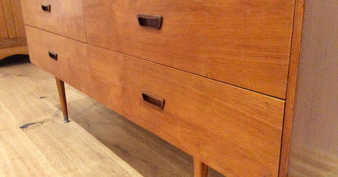 Front View Mid Century Danish Four Drawer Walnut Sideboard with Atomic Legs. Circa 1960.