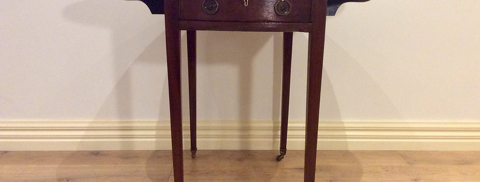 Regency Mahogany Drop Leaf Table with Long Drawer and Rolling Castors.