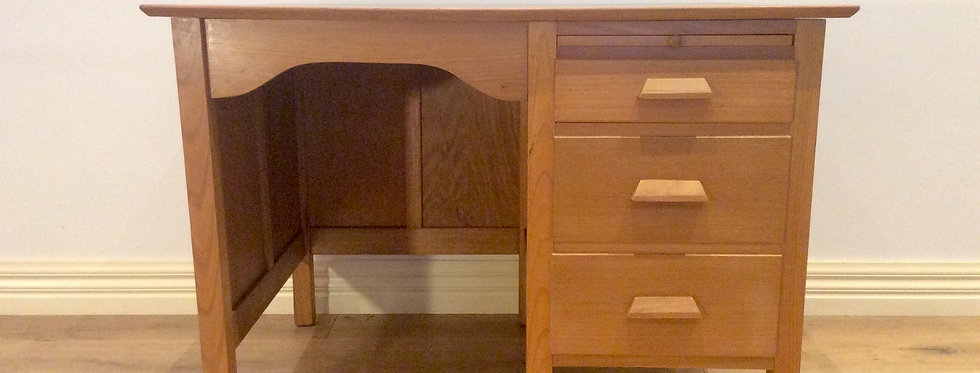 Mid Century Tasmanian Oak Three Drawer Desk.