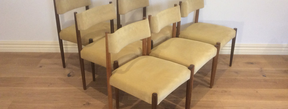 Mid Century Fler Dining Chairs with Floating Backrests.