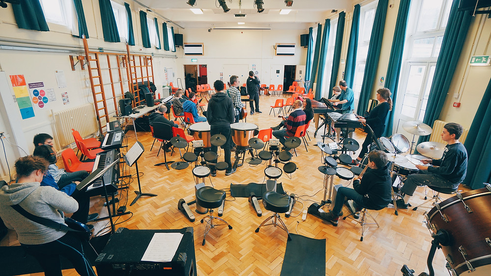 Inclusive orchestra rehearsing with instruments