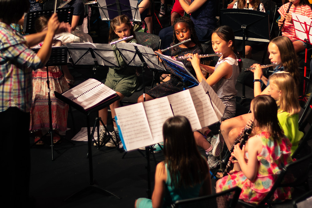 young children playing in an orchestra