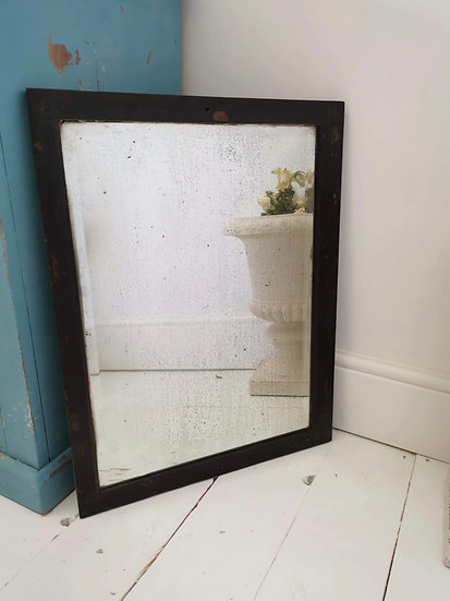 Antique mirror with foxed glass in beautiful ebonised hardwood frame
