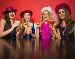 Laughing friends having hen party holdin