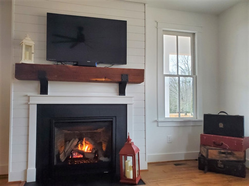 Gas fireplace with reclaimed wood mantel
