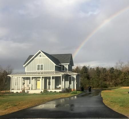 Rainbow behind Four Gables house