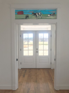 Stainted glass transom over study entrance