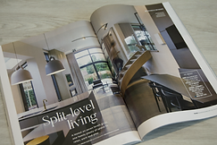 Grand Designs Magazine open on the page showing a feature on a new build home generated by Flourish