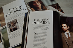 Magazines open showing content and copywriting produced by Flourish
