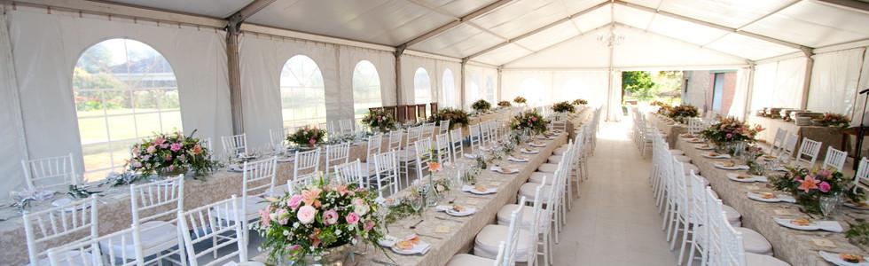 The inside of a massive white wedding te