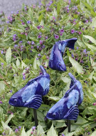 Three blue ceramic fish