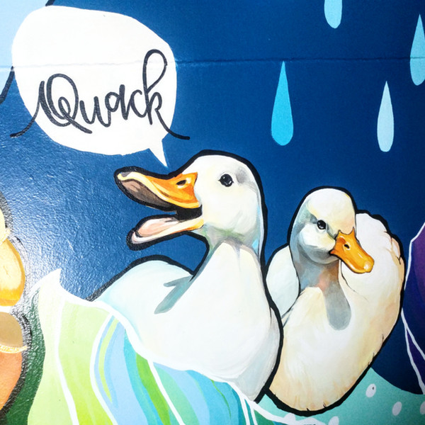 This is a close up image of the painting that wrapped around a smoothie shack for Tsue's Farm out in North Shore on Oahu. Tsue's Farm has many outdoor interactive activities to offer for both leisure and educational purposes. This piece of the mural was inspired by the Pekin Ducks that they have in part with their petting zoo.