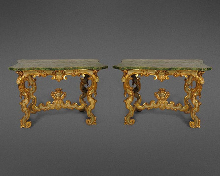 A RARE AND DRAMATIC CARVED PAIR OF ITALIAN 18TH CENTURY PARCEL GILT AND PAINTED CONSOLE TABLES
