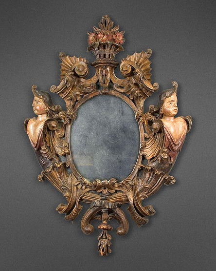 A SPECTACULAR AND WHIMSICAL 18TH CENTURY SPANISH CARVED GILT WOOD MIRROR