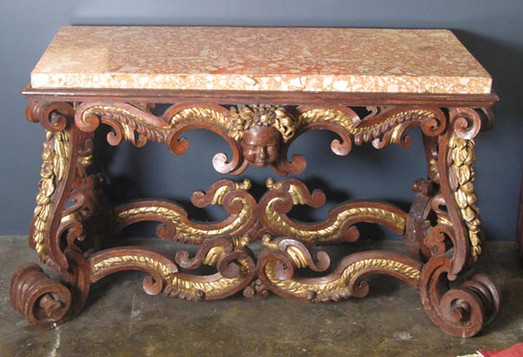 AN EXCEPTIONAL ROMAN BAROQUE PARCEL GILT AND RUST PAINTED CONSOLE TABLE