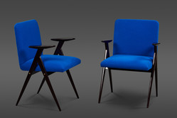 A STRIKING PAIR OF DIMINUTIVE UPHOLSTERED CHAIRS WITH EBONIZED WALNUT FRAMES