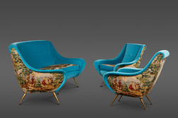 AN ELEGANT SUITE OF A SOFA AND TWO ARMCHAIRS