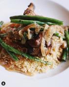 Chicken yassa over couscous
