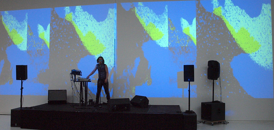 MARTIN REV,  projection DIVINE ENFANT, performing at Mac Val museum photo by Michel Pozzili