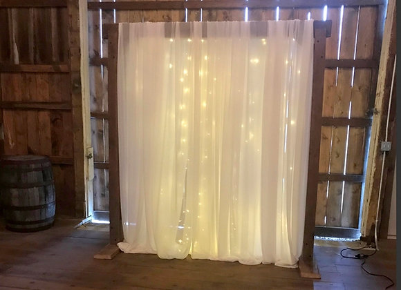 Reclaimed Draped and Lighted Wood Arbor