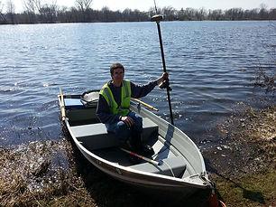 Registered Professional Land Surveyor Working on Lake