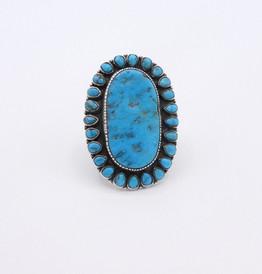 Large turquiose cluster turquoise vintage Navajo ring.