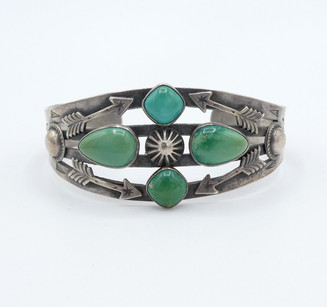Four directional green turquoise vintage Navajo cuff with arrows.