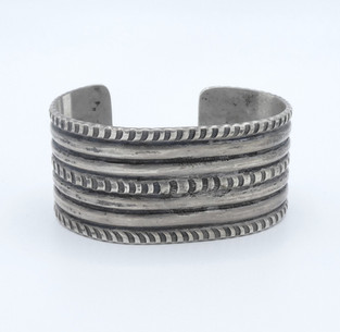 Old pawn classic Navajo silver ribbed and stamped cuff.