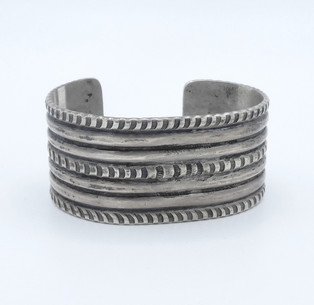 Early old pawn classic Navajo silver ribbed and stamped cuff.