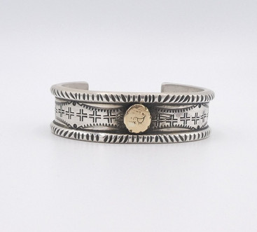 Gold and silver stamped cuff by contemporary artist, Mike Bird Romero.