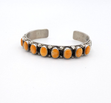 Lovely orange spiny oyster shell and sterling silver row cuff