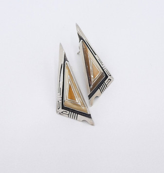 Fossil ivory channel inlay and silver Zuni earrings.