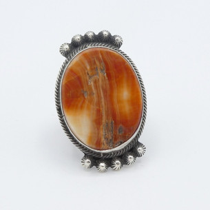 Orange spiny oyster shell and silver ring.