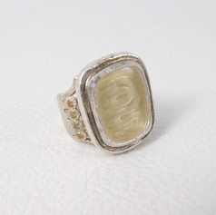 R2. Snake intaglio rock crystal ring with yellow Sapphires.