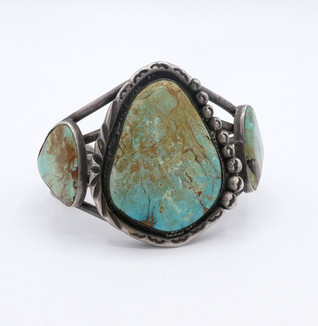 Old pawn vintage Navajo silver stamped cuff set with turquoise.