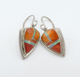 Contemporary Zuni orange spiny oyster shell, opal and silver channel inlay earrings.
