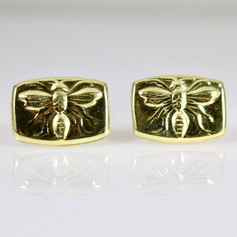 E2. 18ct bee posts.