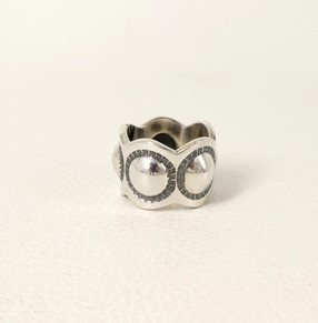 Silver scollaped ring with repousse by Navajo designer Cody Sanderson