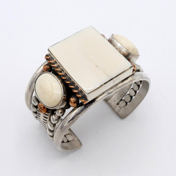 C15 Fossilised Walrus Ivory and silver with copper cuff