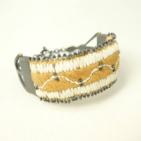 C1.  Buckskin porcupine quill, diamond beads and oxidized sterling