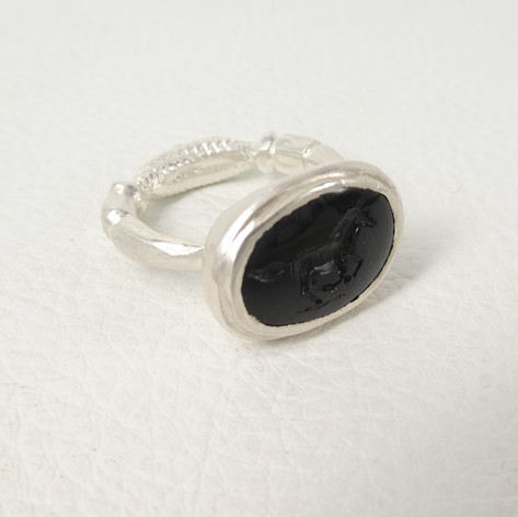 R4. Onyx horse intaglio ring with diamond