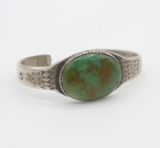 Old pawn Navajo large oval green turquoise stone and stamped silver cuff.