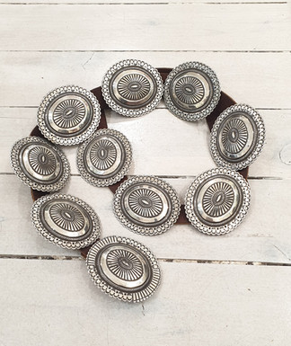 Oustanding silver concho belt with superb stamping, made up of nine conchos and buckle, made by artist Perry Shorty