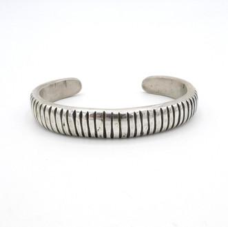 Silver linear narrow cuff by Navajo artist Mike Bird Romero