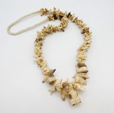 Vintage fossilised marine ivory hand carved fetish necklace